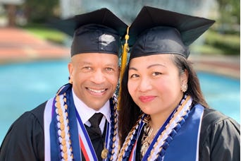 Husband and wife Patrick and Kristine Hawkins graduated from Chamberlain University's nursing program as valedictorian and salutatorian on Friday. He was in the Navy and she was in the Air Force.