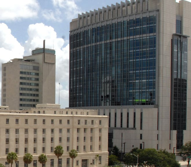 Jacksonville's federal courthouse (right) and State Attorney's Office (left).