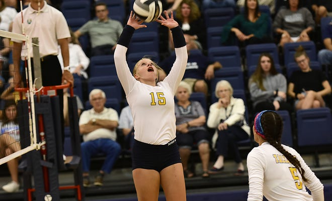 Tallmadge sette Ellie Kirker passes the ball during a game against Aurora last fall. Kirker had a huge match with 42 assists and four aces in Tallmadge's 5-18, 17-25, 17-25, 25-21, 19-17 home win over Wadsworth Sept. 5.