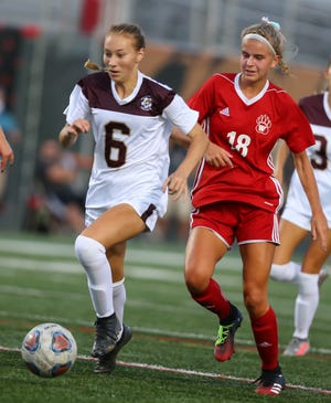 Stow-Murnoe Falls' Kailey Hobart dribbles the ball ahead of Wadsworth's Hailey Bush during the Bulldogs' 0-0 draw with Wadsworth Sept. 9 at Art Wright Stadium.