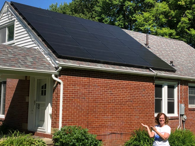 Stow resident Cari Orris shows the solar panels she had installed in her house. She is participating in the National Solar Tour this month.