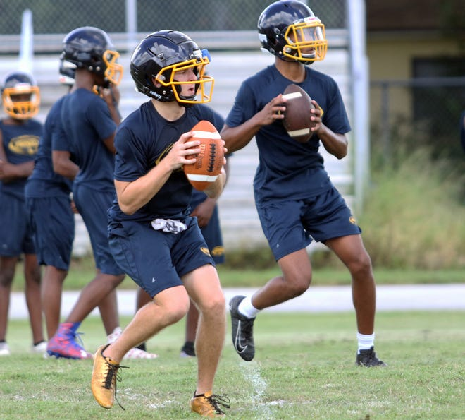 Winter Haven senior Tyler Martin, left, and sophomore Tyler Williams will each see time at quarterback against Victory Christian on Friday. With a short preseason and no kickoff classic, there hasn't been enough time for the starting job to be determined on the field, head coach Charlie Tate said.