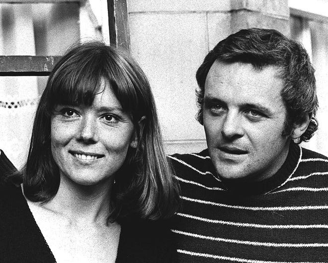 "In this Sept. 20, 1972, file photo, British actress Diana Rigg and actor Anthony Hopkins attend the opening night of ""Macbeth"" at the National Theatre, London. Rigg played Lady Macbeth opposite Hopkins' Macbeth in the Shakespearean tragedy. Rigg, who became a 1960s style icon as secret agent Emma Peel in TV series ""The Avengers,"" has died at age 82. Rigg's agent Simon Beresford says she died Thursday at home with her family."