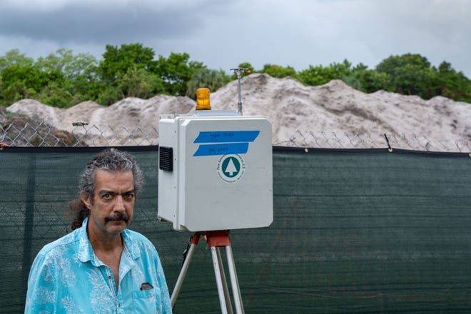 Trevi Court spokesman Rob Jacobs stands next to one of three dust-control monitors in September 2020 where Ridgewood Real Estate Partners is developing land behind Fountains Country Club west of Lake Worth Beach.