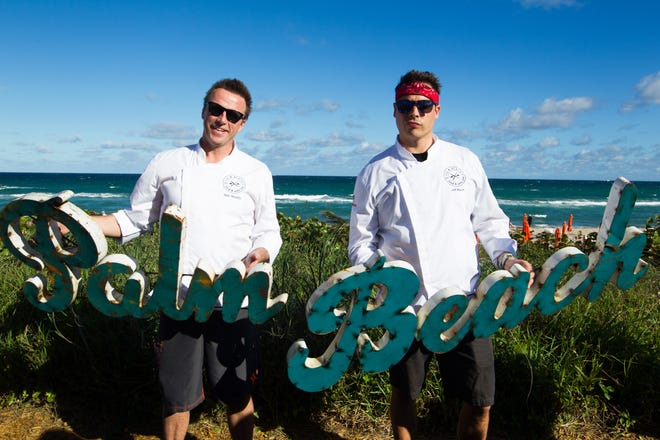 Festival flashback from 2015: Food Network star chefs Marc Murphy (left) and Jeff Mauro pose seaside during the annual Palm Beach Food and Wine Festival.