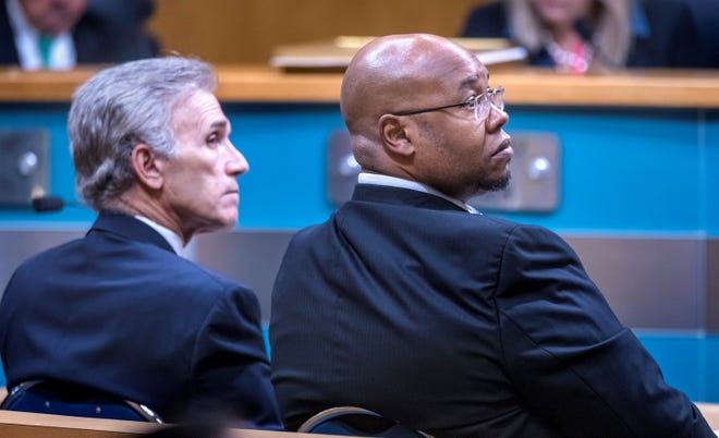 School Board Chairman Frank Barbieri, left, and Superintendent Donald Fennoy listen to another speaker talk about coronavirus preparations during a Palm Beach County Commission meeting in March.  [LANNIS WATERS/palmbeachpost.com]