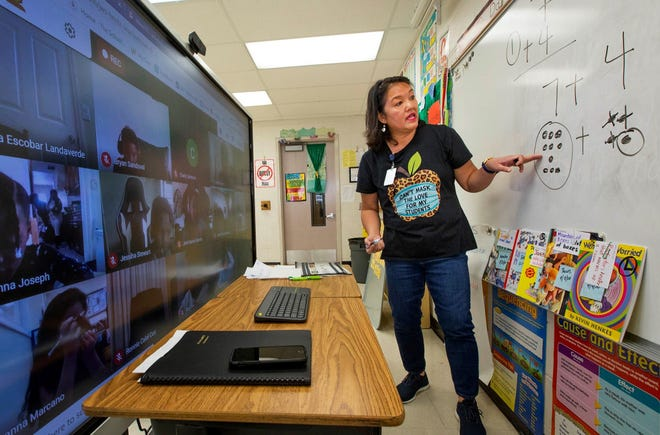 As students watch from their homes, Anna DeOliveira teaches second graders math at Heritage Elementary School in Greenacres on Sept. 4.