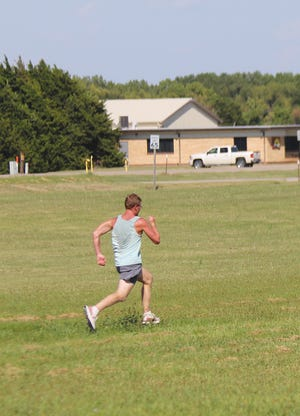 Skyline cross country student-athlete Brock McKennon puts on a burst of speed as he heads for the finish line during team-trial practice last week in Pratt.