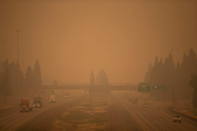 Vehicles travel on I-5 near I-105 as a thick blanket of smoke envelopes the area in Eugene, Oregon on September 10, 2020. Air quality in Lane County continued to be hazardous due to wildfire smoke.