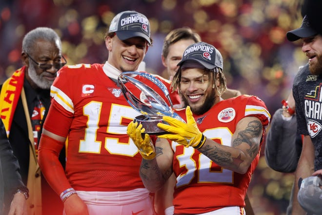 Kansas City's Patrick Mahomes (15) and Tyrann Mathieu hold up the Lamar Hunt Trophy after the winning last year's AFC championship game against the Tennessee Titans, in Kansas City, Mo. The defending Super Bowl champion Chiefs open the NFL season Thursday night against the Houston Texans.