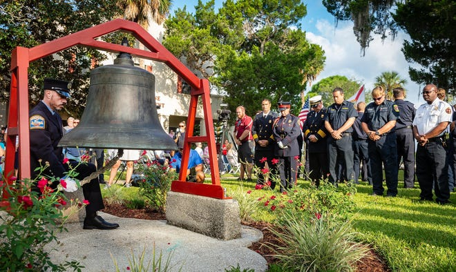 Retired New York City Firefighter Daniel Bryan rings a bell in front of St. Augustine Fire Department's headquarters in the city during a September 11 Ceremony of Remembrance in 2019.