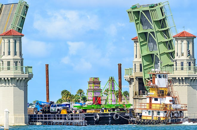 A barge carrying St. Augustine's Confederate monument passes through the Bridge of Lions in the city on Thursday. The structure was being taken up the Intercoastal Waterway and down the St. Johns River to Trout Creek Fish Camp on State Road 13 in western St. Johns County. The monument was moved from the Plaza de la Constitucion on Wednesday.
