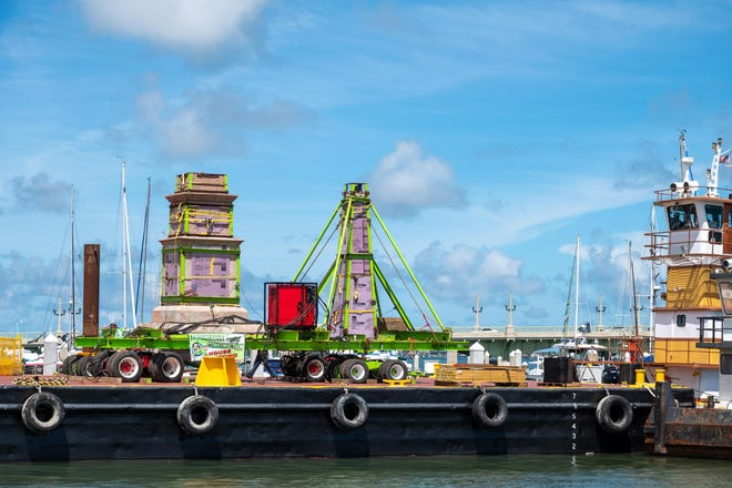 The Confederate memorial that was removed from the Plaza de la Constitucion in St. Augustine is loaded onto a barge. It was taken to Trout Creek Fish Camp on State Road 13 in St. Johns County.