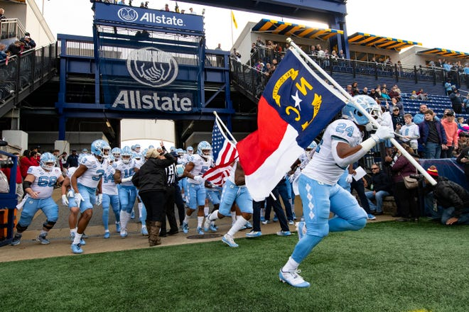 Dec 27, 2019; Annapolis, Maryland, USA;  North Carolina Tar Heels runs onto the field prior the the game against the Temple Owls at Navy-Marine Corps Memorial Stadium.