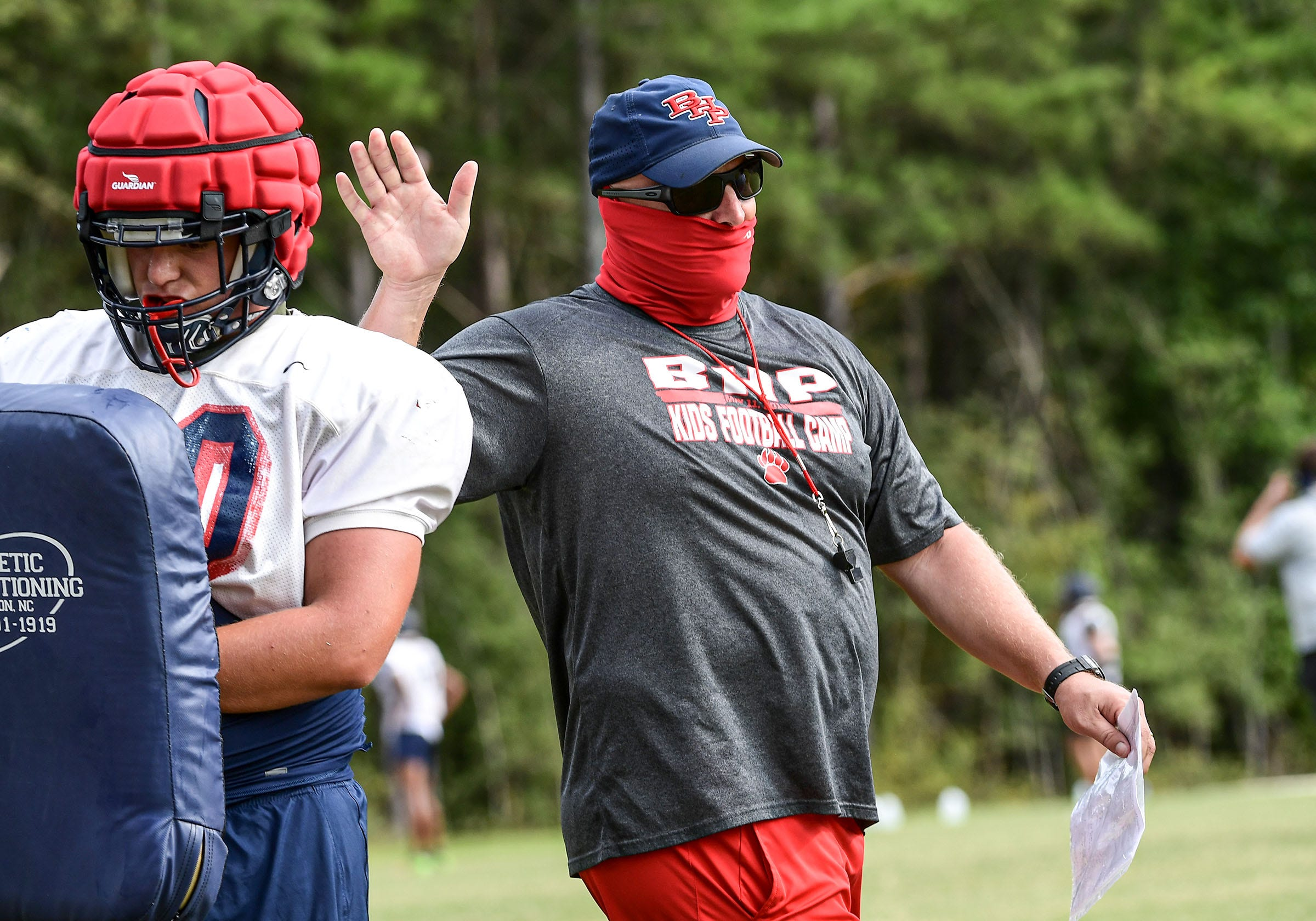 Belton-Honea Path football Head Coach Russell Blackston works with offensive linemen during practice in Honea Path, S.C. Wednesday, September 9, 2020.