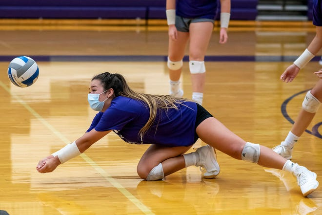 Lakeview senior Gabby Oursler dives for the ball during the first indoor practice of the season on Wednesday, Sept. 9, 2020 at Lakeview High School in Battle Creek, Mich.