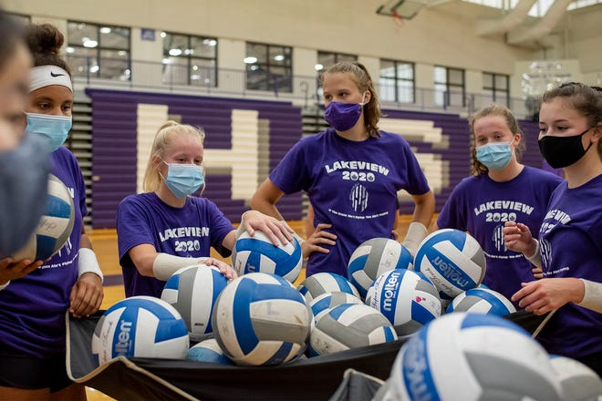 Lakeview volleyball players shag balls during their first indoor practice of the season on Wednesday, Sept. 9, 2020 at Lakeview High School in Battle Creek, Mich.