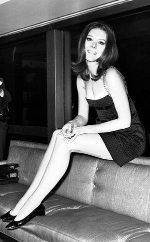"FILE - In this Nov. 8, 1967 file photo, British actress Diana Rigg poses for photographers during a press conference at the Hilton Hotel, London. Actress Diana Rigg, who became a 1960s style icon as secret agent Emma Peel in TV series ""The Avengers,"" has died at age 82. Rigg's agent Simon Beresford says she died Thursday Sept. 10, 2020 at home with her family. (AP Photo/Bob Dear, File)"
