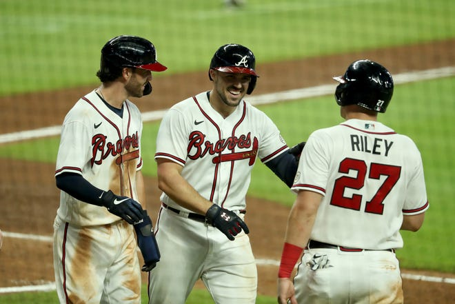 Atlanta Braves outfielder Adam Duvall (23) celebrates after he hit a grand slam in the seventh inning against the Miami Marlins at Truist Park on Sept. 9.