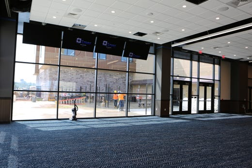 Construction workers can be seen working through the windows of the new Oak Grove Racing & Gaming facility a week before they open to the public on Sept. 18, 2020.