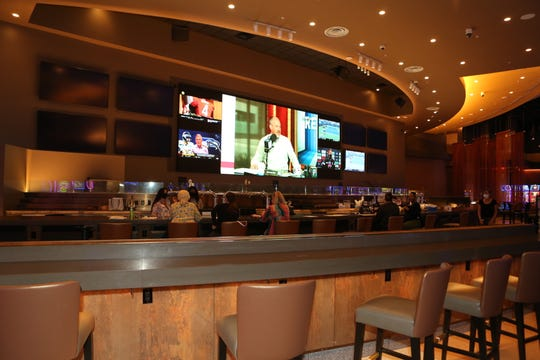 A view of the sports bar with its 32-foot television at the new Oak Grove Racing & Gaming facility, set to open to the public on Sept. 18, 2020.