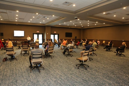 Employees at the new Oak Grove Racing & Gaming facility sit socially distanced during a training session a week before they open to the public on Sept. 18, 2020.