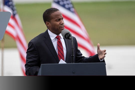 Senate candidate John James speaks during a President Donald Trump rally at the MBS International Airport in Freeland, Thursday, Sept. 10, 2020.