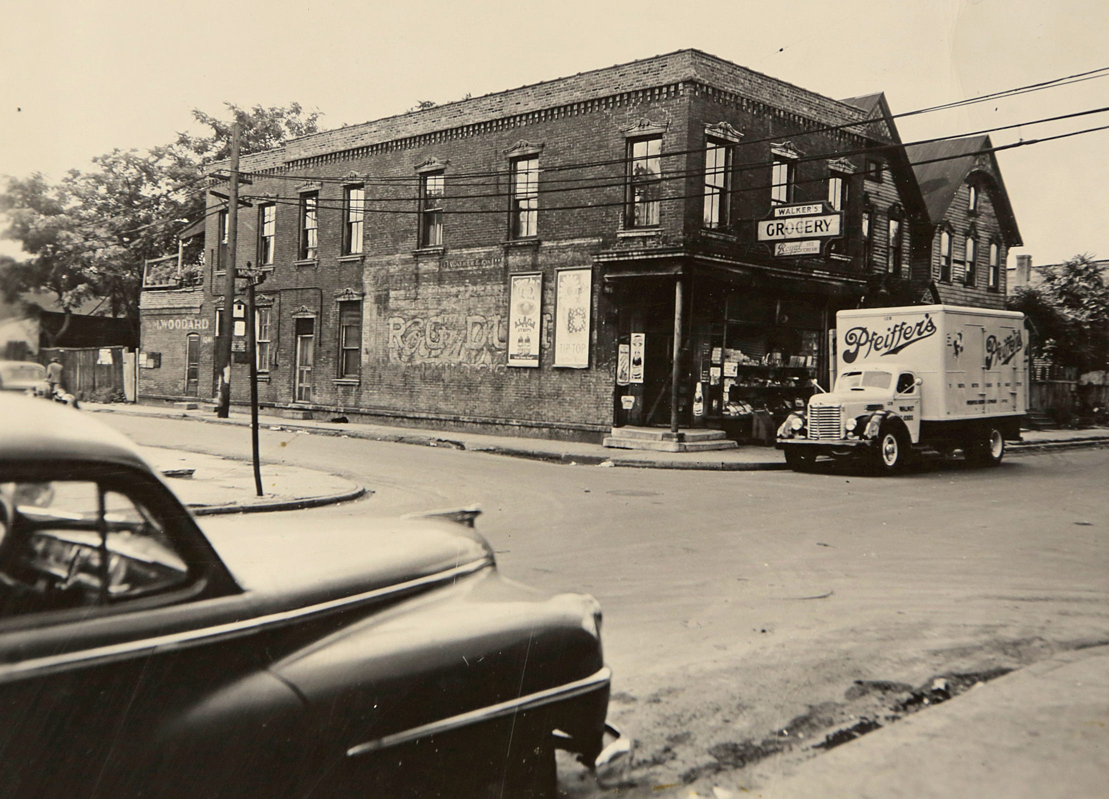 This is a historical photo of Black Bottom before it was torn down in the 1950s to make way for the Chrysler Freeway and the Detroit Medical Center. In this photo a grocery store sits at the corner between 1488 and 1490 Monroe St. and 1041 Riopielle St. on September 1, 1949 in Black Bottom, the ancestral neighborhood of many metro Detroit African Americans. Courtesy of the Burton Historical Collection
