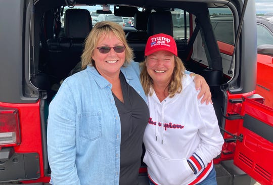 Tina Oldford, left, and Jennifer Hay traveled from Howell to see President Donald Trump's rally at MBS International Airport in Freeland, Michigan on Thursday, Setp. 10, 2020. Both said they had never voted before, but planned to cast their ballots for Trump this fall.