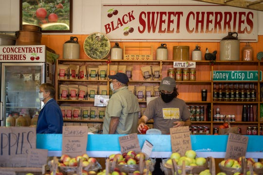 Customers shop for fruit goods at King Orchards in Kewadin on Friday, September 4, 2020.
