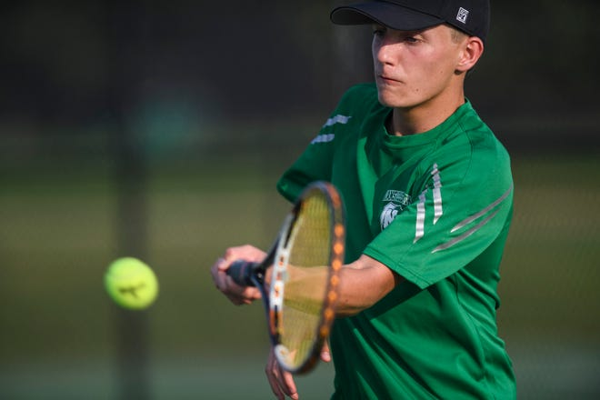 North's Cole Decker returns a serve from Memorial's Shaurya Jadhav during a singles match at North High School in Evansville, Ind., Wednesday evening, Sept. 9, 2020.