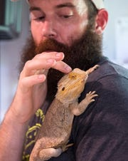 Adam Pottruck of Adam's Animal Encounters holds one of his bearded dragons at his Pine Island home on Wednesday, September 9, 2020.