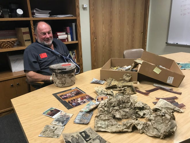 Former Sevastopol School teacher Mike Madden looked through photos and newspapers his class buried in a time capsule nearly 40 years ago.