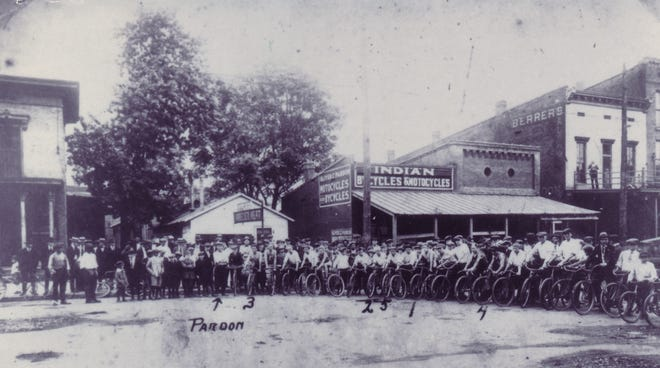This photo, which T.R. Holliday provided to The Gleaner for its 1996 pictorial history, depicts a June 1920 bicycle race sponsored by Oliver Z. Pardon and his Indian motorcycle and bicycle dealership at 132 N. Elm St. The Pardon store sponsored Henderson's first formal bicycle race in 1916, although the bicycle had made its first appearance here in 1881.