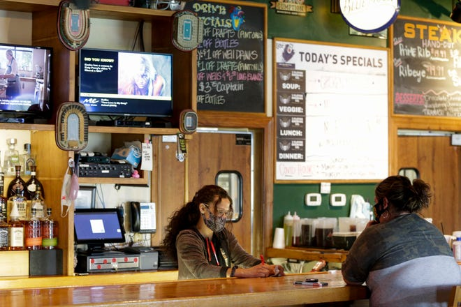 Mariah Collins takes a customer's order from the bar at Hunter's Pub, 1092 Sagamore Parkway W., Thursday, Sept. 10, 2020 in West Lafayette.