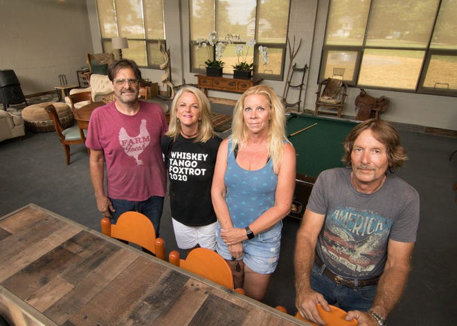 From left, George Miller, building owner Lori Cook, Kristen Kern and Dan Drew work together to fix up the former Parkers Corners School, shown Tuesday, July 21, 2020.