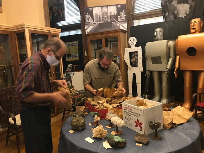 A mineral collection found its way back to the Mansfield Memorial Museum this past week after a 60-year hiatus. At left, Scott Schaut, curator of the 34 Park Avenue West museum, and Jason Larson of the Mid-Ohio Mineral and Fossil Club, examine some of the minerals that Larson donated to the museum. Lou Whitmire/News Journal