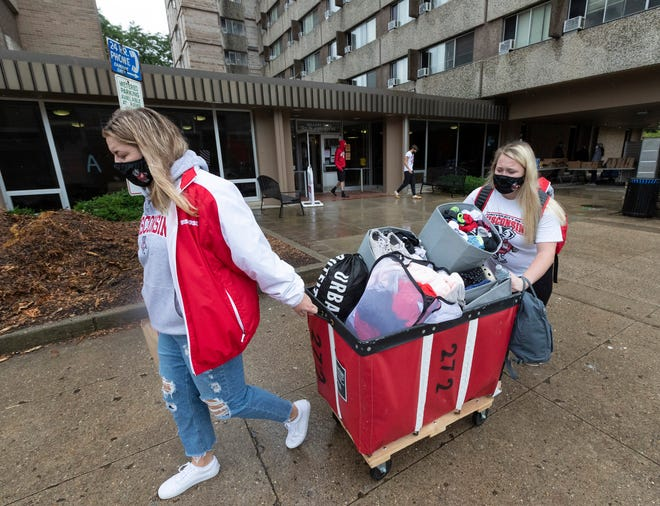 Freshmen Lauren Tamborini and Bailey Donahue move out of Sellery Residence Hall at the University of Wisconsin last week as an increase in coronavirus cases led to a lockdown of the campus.