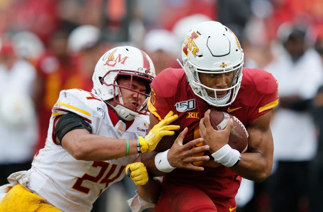Iowa State quarterback Re-al Mitchell runs the ball as he is tackled by Louisiana-Monroe linebacker Keyshawn Johnson, left, during the second half of an NCAA college football game, Saturday, Sept. 21, 2019, in Ames, Iowa. (AP Photo/Matthew Putney)