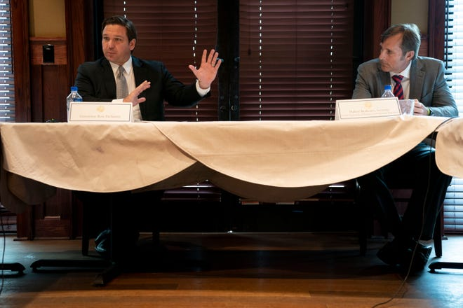 Gov. Ron DeSantis, left, and Halsey Beshears, right, Department of Business and Professional Regulation secretary, participate in a restaurant roundtable at Connor's Steak & Seafood in Fort Myers on Sept. 10.