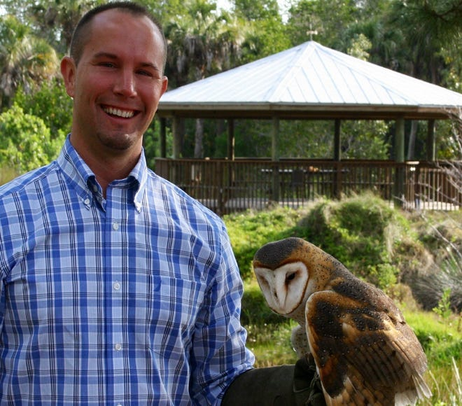 David Webb with a barn owl he trained at the Conservancy in Naples. He is a certified animal trainer and has worked with many species of ambassador animals including birds of prey in education programs.