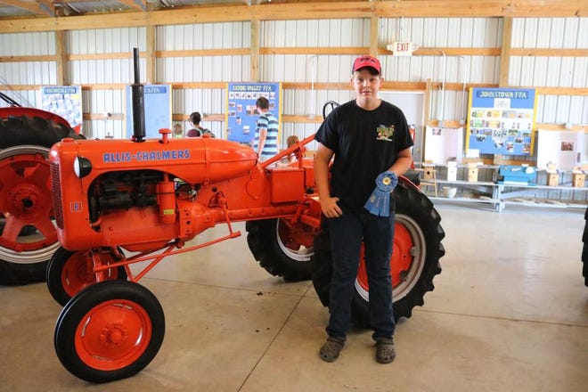 Utica FFA Chapter member Todd Orr had a restored tractor, and he earned best in show at the Hartford Independent Fair.