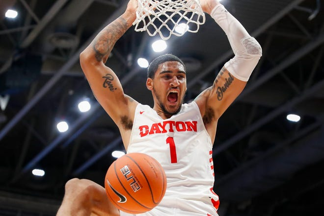 Dayton's Obi Toppin dunks during the first half of an NCAA college basketball game against Drake, Saturday, Dec. 14, 2019, in Dayton, Ohio. (AP Photo/John Minchillo).