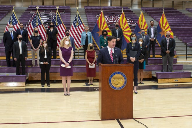 Arizona Gov. Doug Ducey speaks at a press conference held at the Hamilton High School gym on Sept. 10, 2020, in Chandler.