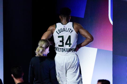 Milwaukee Bucks' Giannis Antetokounmpo leaves the court after hurting his ankle during the first half of an NBA conference semifinal playoff basketball game against the Miami Heat Sunday, Sept. 6, 2020, in Lake Buena Vista, Fla. (AP Photo/Mark J. Terrill).