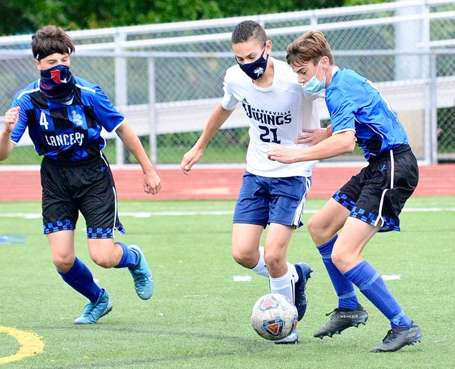 Marysville freshman Tyler Dimmick battles for possession during the Vikings' Macomb Area Conference-Gold boys soccer match on Wednesday, Sept. 9, 2020, at L'Anse Creuse in Harrison Twp.