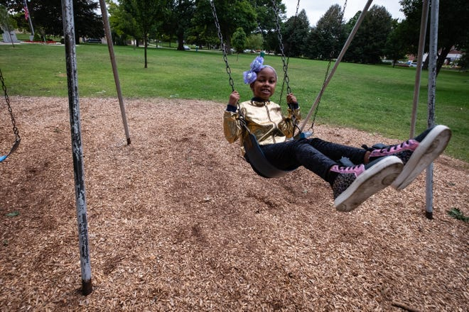 Cavonna Nance, 8, plays on the swings Thursday, Sept. 10, 2020, at Pine Grove Park in Port Huron. The Garfield Elementary third-grader was diagnosed with Pilocytic astrocytoma in July 2018.