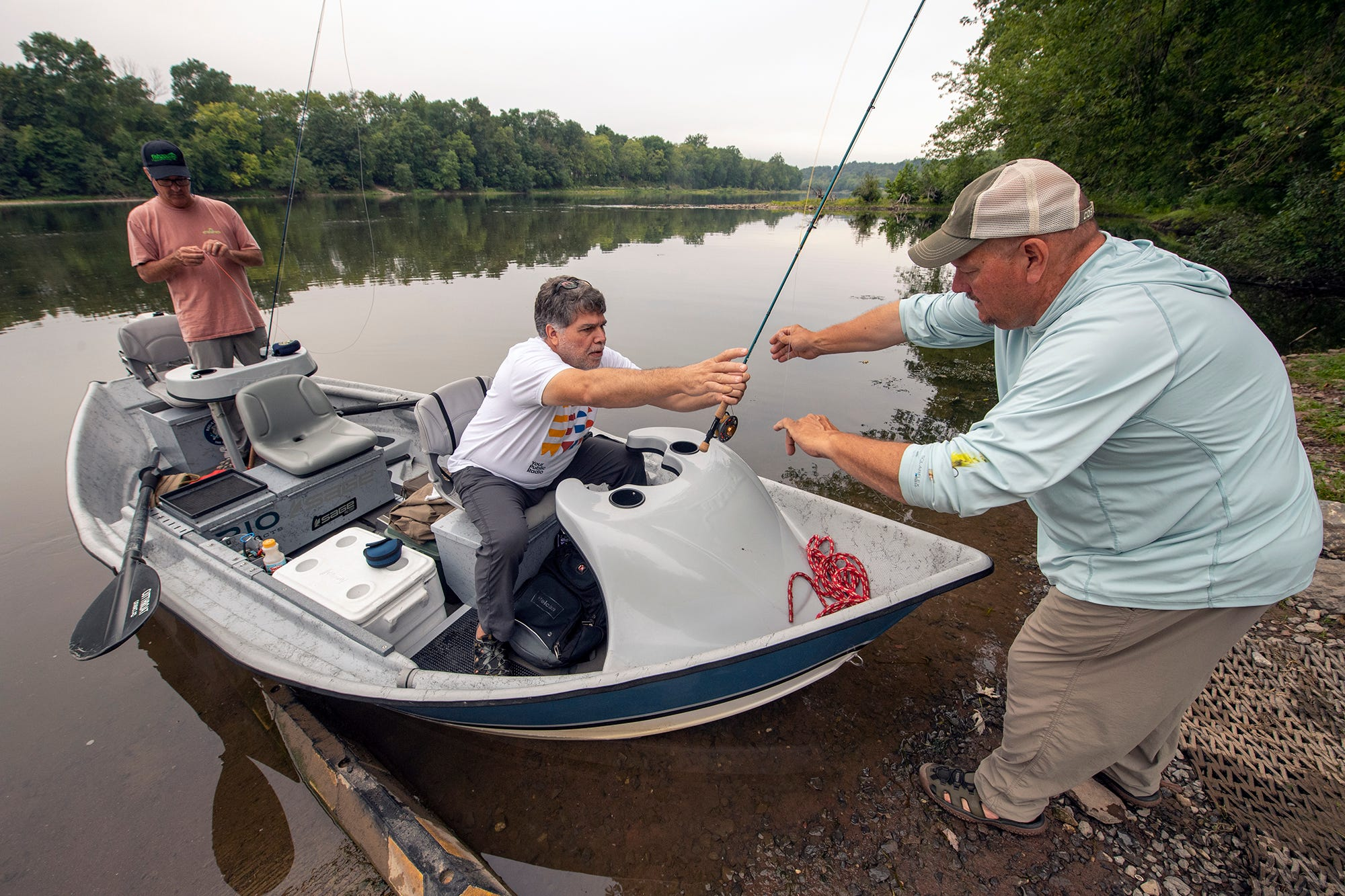 From right, Brian Shumaker helps Scott Wehage, 52, from Jarrettsville, Md. and Mike Stotler, 50, from Forrest Hill, Md. board his boat for a fishing trip on the Juniata River near Newport, Pa. The Juniata is a major tributary of the Susquehanna River.