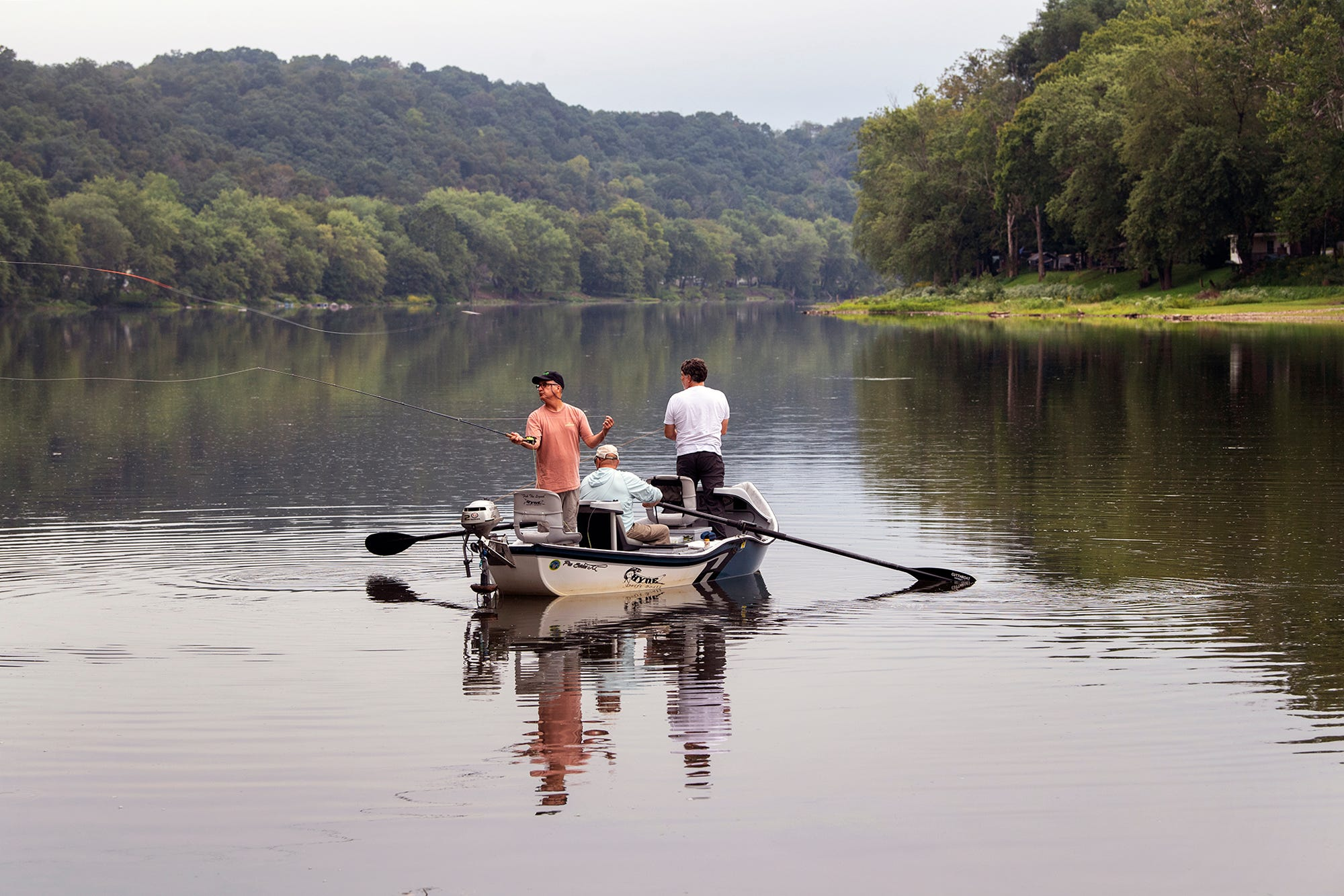 Brian Shumaker rows down the Juniata River near Newport, Pa. while he takes two clients on a fishing trip. The Juniata is a major tributary of the Susquehanna River.