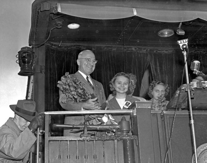 Eleven-year-old Gertrude Rose Walterman presented Richmond roses to President Truman when he stopped in Richmond on Oct 12, 1948.  Note the WKBV microphone.